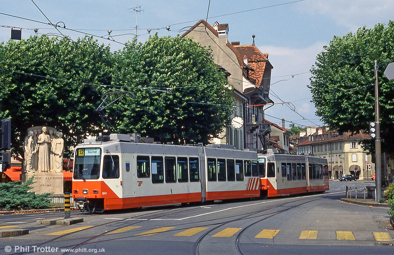 Car 841 at Place du Rondeau, Carouge in August 1995. In 1772, the people of Turin came to Carouge to set up a town to rival Geneva. Carouge changed hands frequently but, in 1816, the town was annexed to Geneva through the Treaty of Turin and became Swiss. The monument (left) commemorates Carouge joining Geneva in 1816.