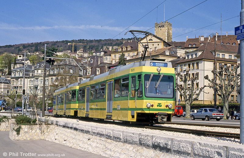 The Neuchatel tramway was modernised in 1981, initially, with four new motorized cars, Be 4/4 501-504 and four driving trailers, 551-554. Car 501 is seen here arriving at Neuchatel on 14th April 1992.