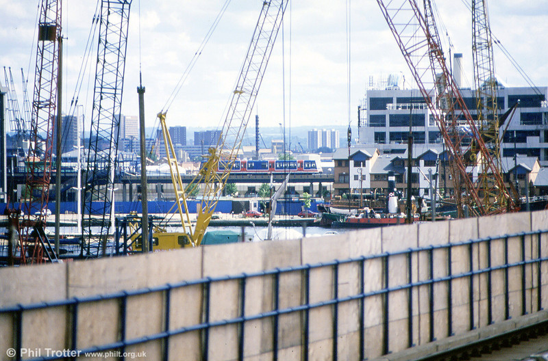 A DLR car amongst cranes during the construction of Canary Wharf.