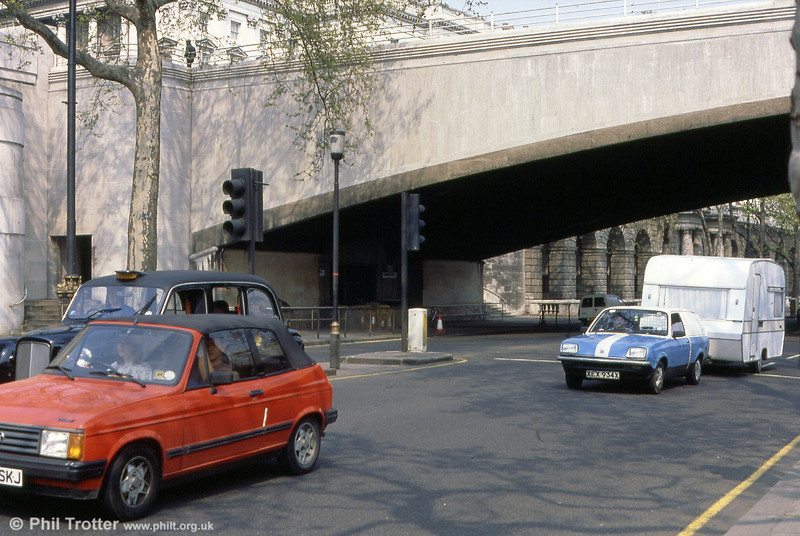 The former southern entrance/exit to the Kingsway Subway (left) beneath Waterloo Bridge on 27th April 1991. When was the last time you saw a Vauxhall Chevette towing a caravan...?