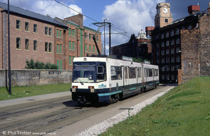 Sunny Manchester: 1010 'Manchester Champion' in the sunshine at Shudehill on 5th June 1994.