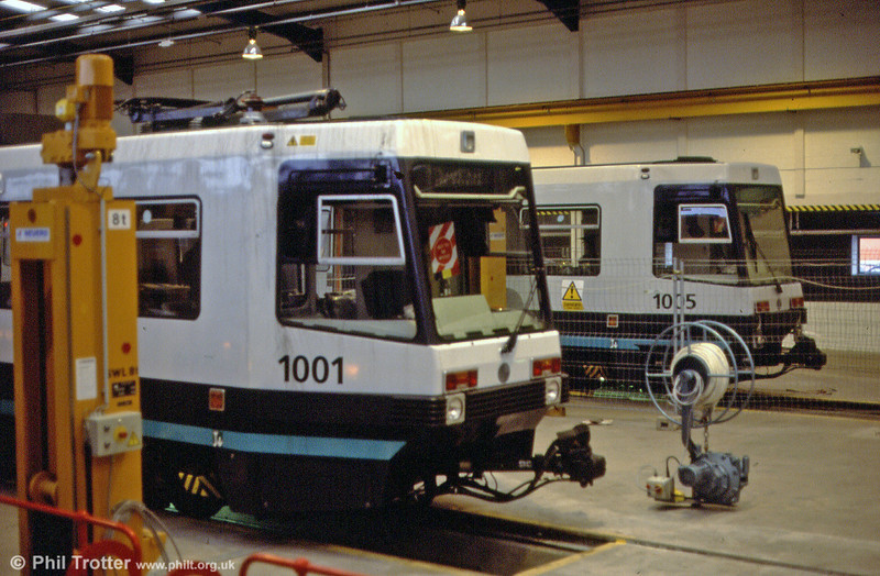 1001 and 1005 inside the workshop at Queens Road depot on 24th November 1991.