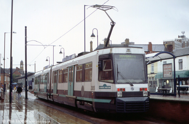Metrolink 2005 'W H Smith West One' at Eccles on 26th June 2004. 2005 is one of six T68M cars purchased for the Eccles route in 1999. These cars are fitted with ac traction equipment, as opposed to the dc motors of the T68s.