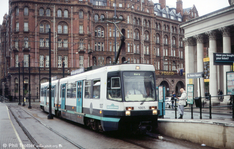 1007 at St. Peters Square on 26th June 2004. On 27 April 1992, 1007 operated the ceremonial first public service into the city, wearing a special headboard. 1007 was chosen as it carries the number of the last first generation tram to operate in Manchester on 10 January 1949.