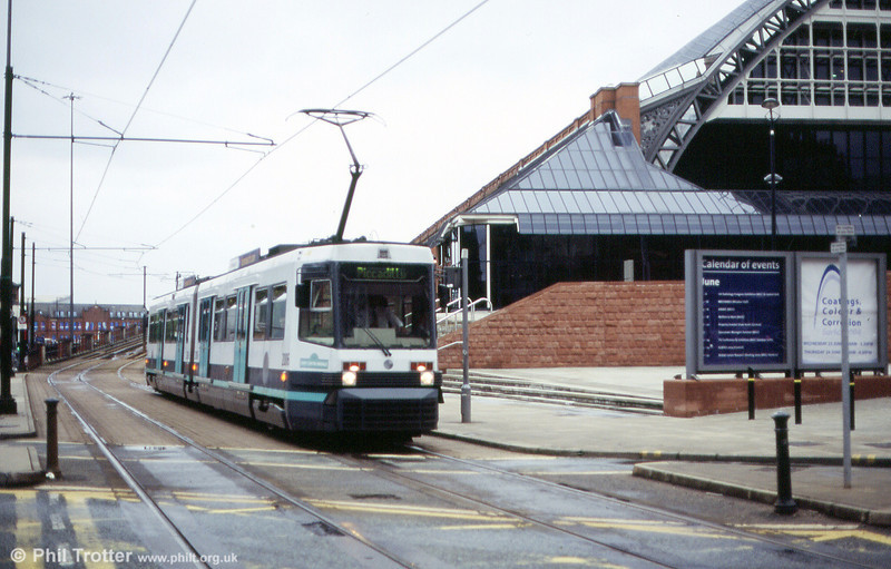 2006 'Sony Centre Arndale' passes G-Mex on 26th June 2004.