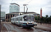 Metrolink T68M car 2005 'W H Smith West One' splashes through Salford Quays on 26th June 2004.