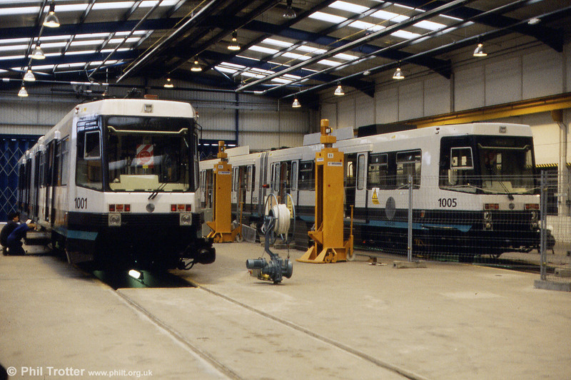Cars 1001 and 1005 inside the workshop at Queens Road depot on 24th November 1991.
