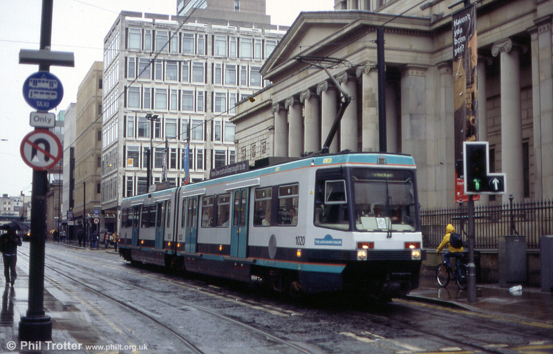Manchester Metrolink's original Firema T68 cars are currently undergoing a programme of refurbishment. This is car 1020 'The Lancashire Fusilier' exhibiting the new livery of refurbished cars, with additional areas of blue, in Mosley Street on 26th June 2004. First published in Tramways & Urban Transit, August 2004.