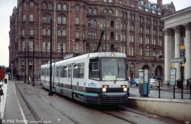 One of the Firema T68 cars which has been modified with coupling and bogie covers to work on the Eccles route, this is 1005 at St. Peter's Square on 26th June 2004, with the Midland Hotel as a backdrop...
