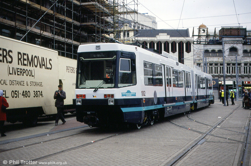 A Metrolink car makes its first appearance on the streets of Manchester. 1002 'Manchester Arndale Voyager' is towed through Moseley Street on 24th November 1991.