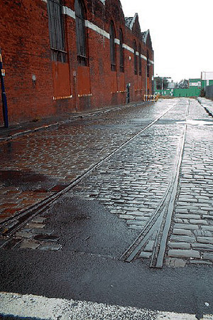 A view along Hessel Street, Weaste showing the tram rails which led to the rear of the depot building. June 2004.
