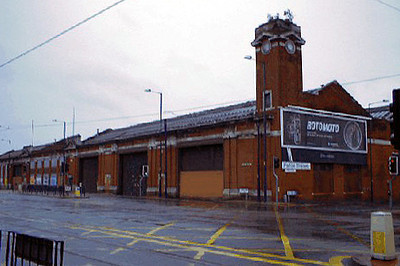 The former Salford Corporation tram depot at Weaste, seen in June 2004. Salford's trams ceased to run in 1947 and the building ceased to be a bus depot in 1986. Metrolink lines are in the foreground.