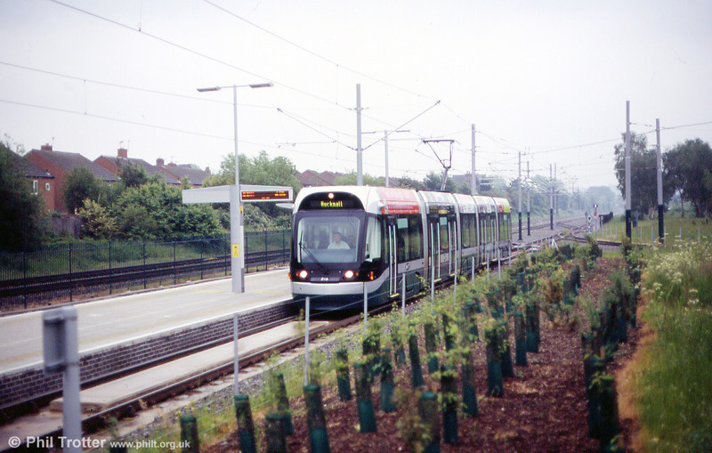 Car 210 at Highbury Vale, where the line to Phoenix Park divides on 29th May 2004.