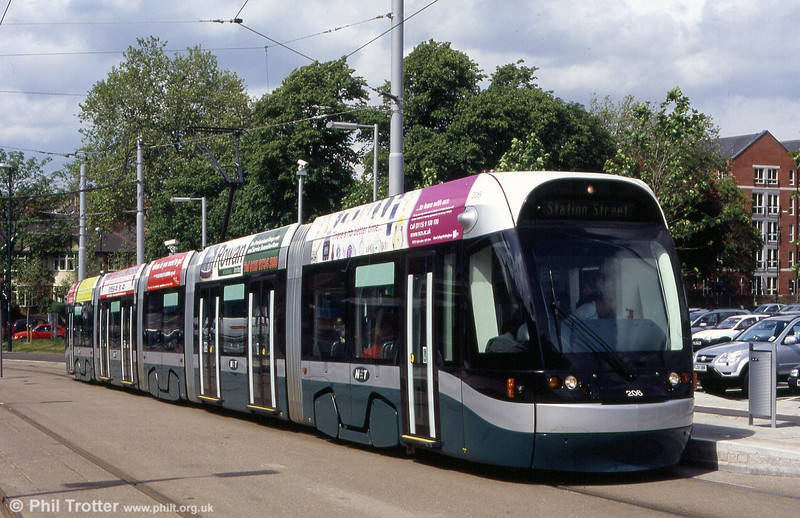 Nottingham NET 206 at The Forest on 29th May 2004. The 5 segment cars are 33m in length and have 62 seats. When full, they can hold up to 191 passengers.