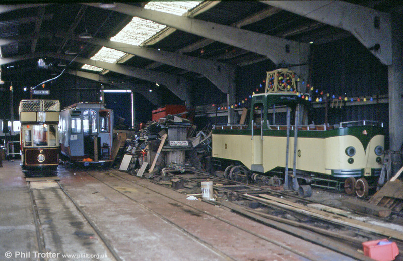 A view inside Seaton depot on 30th June 1990, with cars 7 and 4. Car 16 is under construction in the centre.