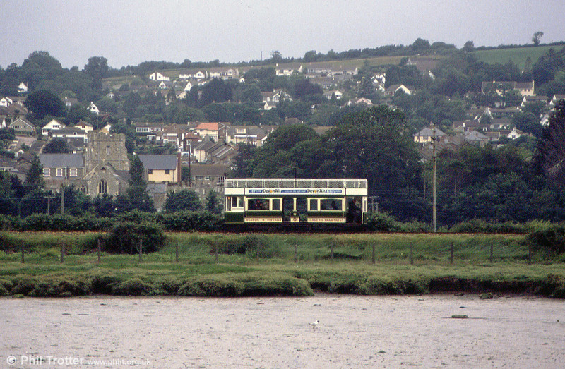 Car 8 runs alongside the River Axe on 1st July 1990. A feature of Seaton Tramway operations are out of hours specials run for birdwatchers.