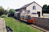 Seaton 2 arrives at Colyton on 30th May 1994. This is the former Colyton station with the converted goods shed, right.