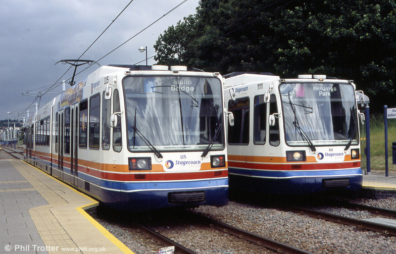 Sheffield Supertram cars 115 and 111 pass at the Rail Station stop on 20th June 2004.
