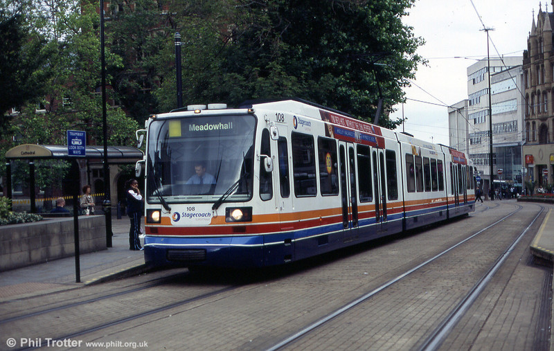 The Purple route in Sheffield runs from Herdings Park to Meadowhall via Cathedral, where cars reverse. 108 is seen here running 'wrong line' before reversing and proceeding to Meadowhall as a Yellow route car. 20th June 2004.