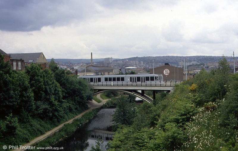 A Supertram car crosses the Sheffield and Tinsley Canal at Attercliffe on 4th June 1994.