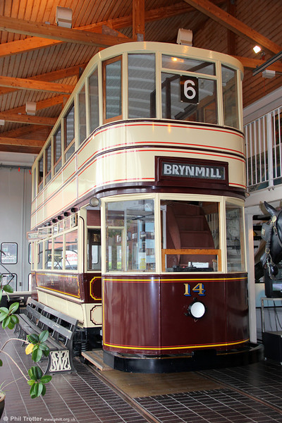 Swansea Improvements & Tramways Brush-built car 14 of 1923 at Swansea Maritime & Industrial Museum on 10th September 2011. This has been rebuilt from no. 14's lower deck and no. 12's upper deck with a truck from Brussels; at one time there was a scheme for an operational heritage tramway at Swansea Museum. The Swansea system operated a varied selection of cars, many obtained secondhand from other systems. Low bridges in the docks area necessitated a fleet of single deckers. Double deck vehicles were used mainly on services to the west of the town centre. A fleet size of around 80 was maintained for many years.