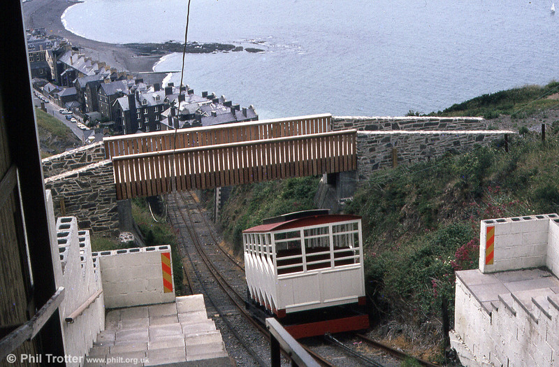 The Aberystwyth Cliff Railway opened in 1896 and operated on a water balance system until electrification in 1921. One of the two cars is seen in July 1984.