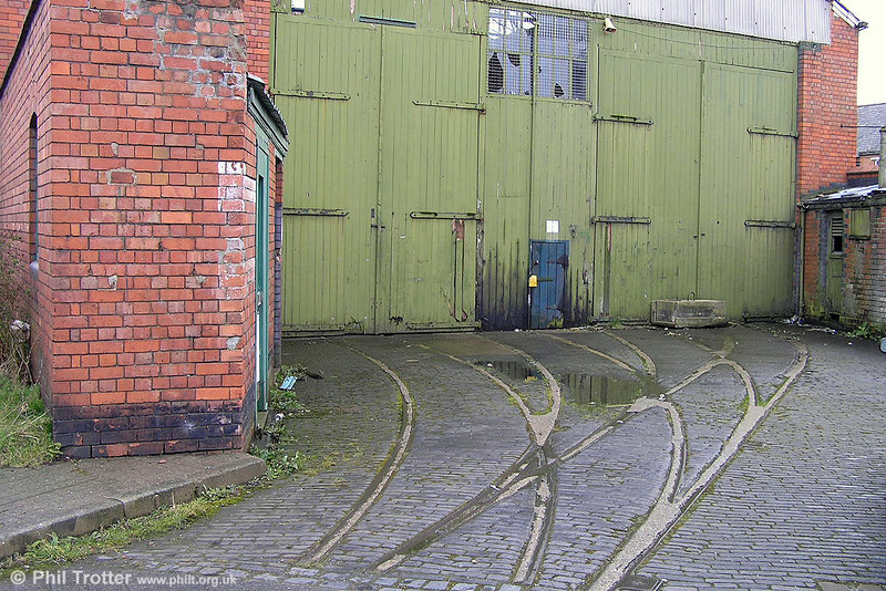 "Tramway remains at Johnstown depot, Wrexham on 15th March 2005. The depot was completed in 1902/3 for the Wrexham & District Electric Traction Co. The company ran ten double deck cars from Brush on the 4.4 mile 3' 6"" gauge single route between Wrexham and Johnstown."