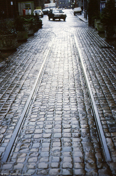"""The remains of first generation tramways can be found in several cities around the UK. Here, a section of 3' 6"""" gauge track can be seen in Edmund Street, Birmingham in January 1989."""