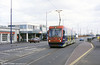 On the Priestfield - Bilston Road section of Midland Metro where there is street running, car 03 heads for Wolverhampton.