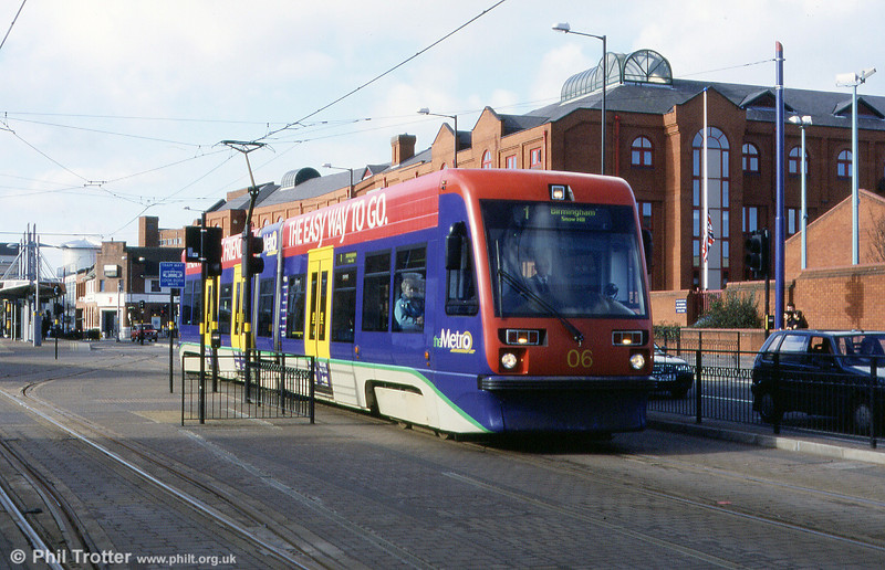 Midland Metro car 06 departing from Wolverhampton at the start of the 14 mile run to Birmingham (Snow Hill). Note the short section of interlaced track (left).