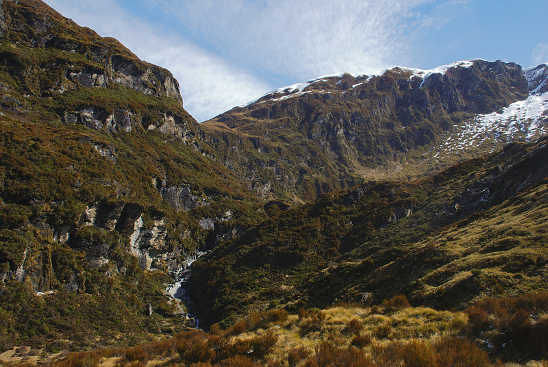 Albert Burn: view up valley from the end of the track. The route continues past the scrubby gorge, then up the valley (not visible) that comes in from the left
