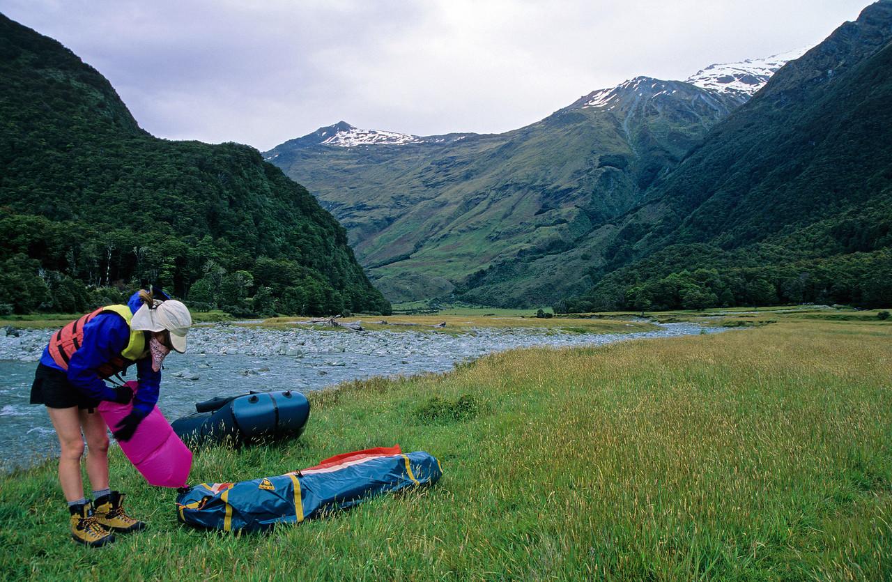 Inflating the pack rafts, near Aspiring Hut