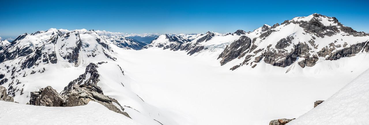 The Olivine Ice Plateau and surrounding peaks from Blockade Peak. From left to right are Ark, Intervention Ridge, Gable Peak, Passchendaele Peak, the Memorial Icefall, Destiny Peak and Climax Peak.