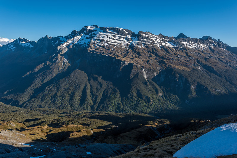 The Forbes Mountains from a campsite below Seal Col, Barrier Range. The peaks on the skyline are, from left to right, Mount Clarke, OSONZAC Twins, Moira Peak, Mount Head, Sir William Peak, Mount Earnslaw, Pluto Peak.
