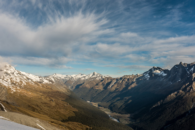View into the head of the Dart River and Cattle Flat from a campsite below Seal Col, Barrier Range. The most prominent peaks on the skyline are Mount Ansted, Mount Tyndall, Headlong Peak, Mount Clarke, OSONZAC Twins.