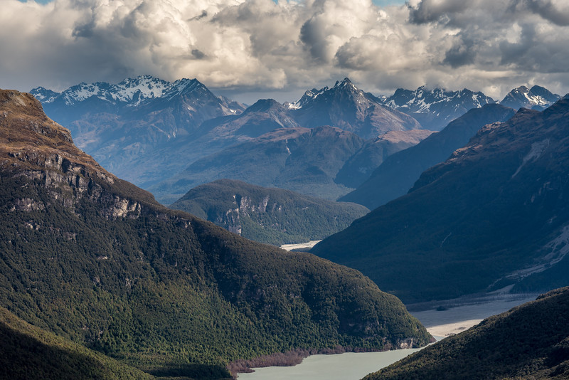 View down the Dart River and lake from the spur below Seal Col. Sandy Bluff (front) and Chinamans Bluff (rear) are at centre image. Mount Bonpland and Upper Peak are on the skyline.