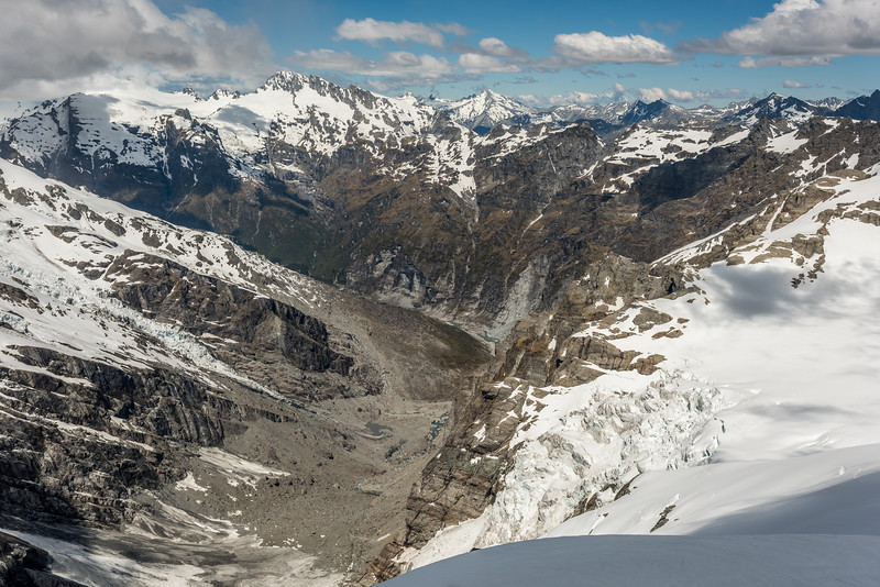 The head of the Joe River and the Derivation Icefall from Mount Gates. Mount Ian is the prominent peak left of centre image. Mount Tewha is in the background, right behind O'Leary Pass.