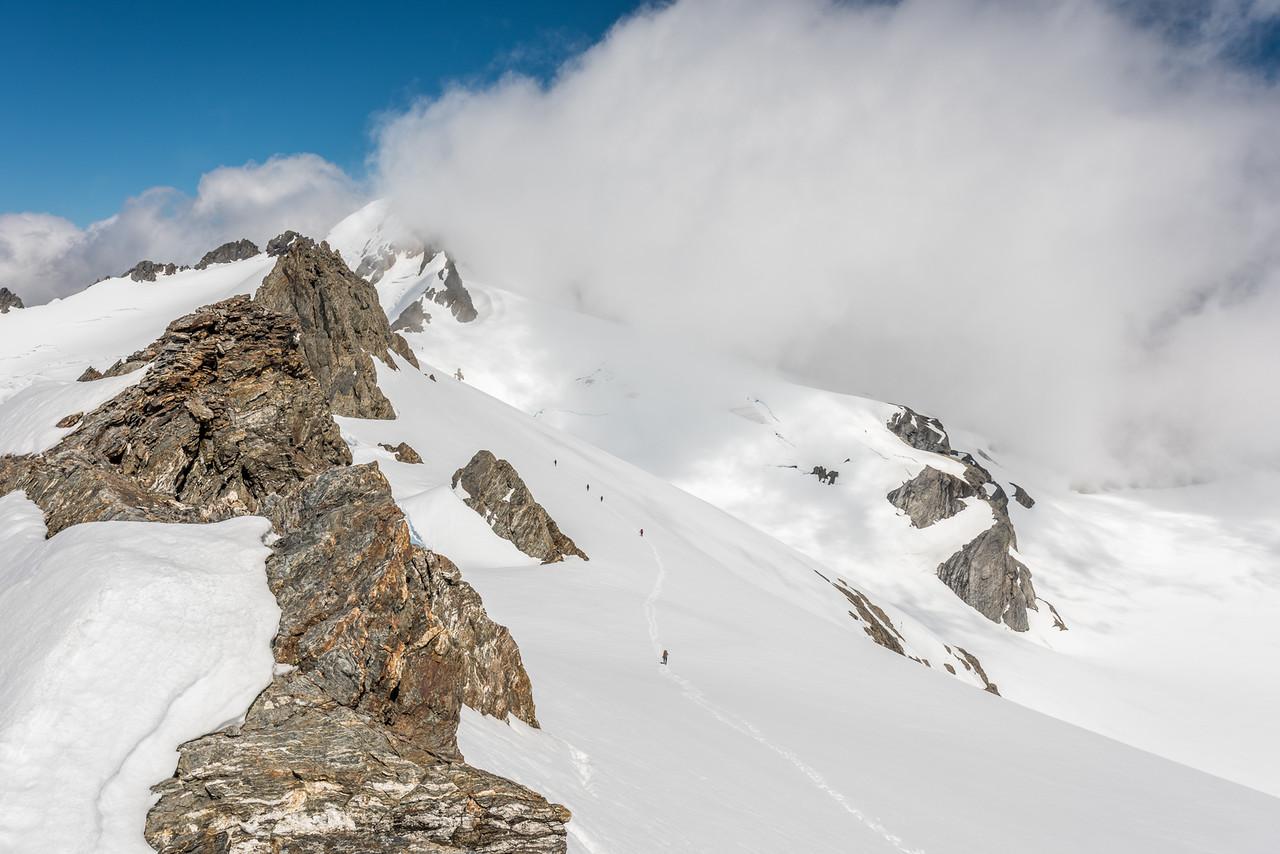Sidling off Watkins towards Glacier Col. Albert Peak is partially hidden in cloud in the background.