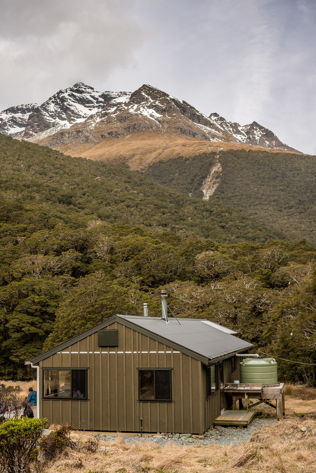 McKellar Hut (Greenstone Track), with Pt 1999m (Ailsa Mountains) above