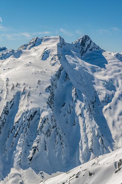 Headlong Peak and Mount Tewha from Cleft Peak.