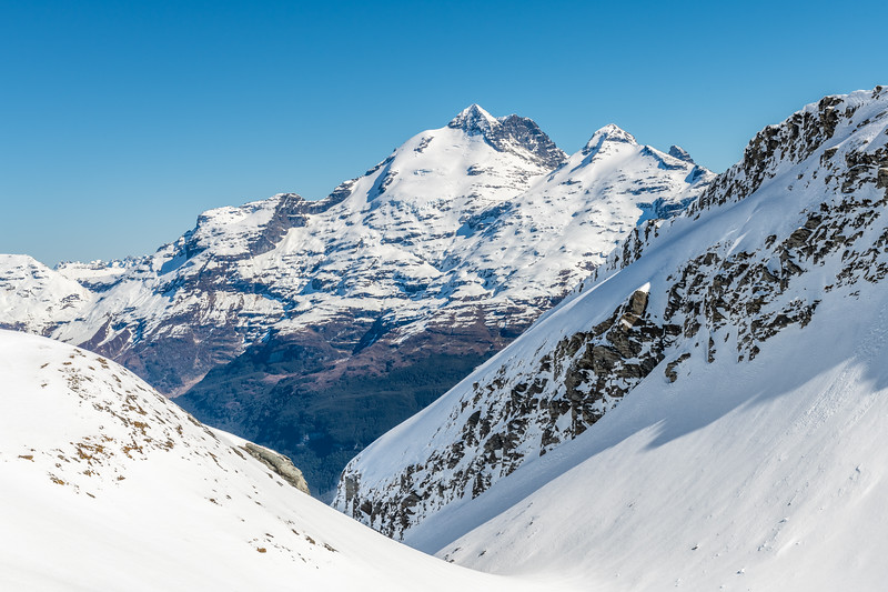 Mount Earnslaw, O'Leary Peak and Pluto Peak from the slopes of Cleft Peak.