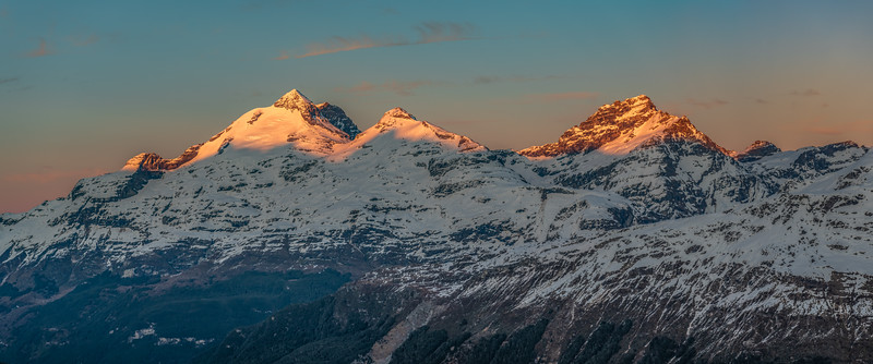 Mount Earnslaw, O'Leary Peak and Sir William Peak at sunrise, from the slopes of Cleft Peak.
