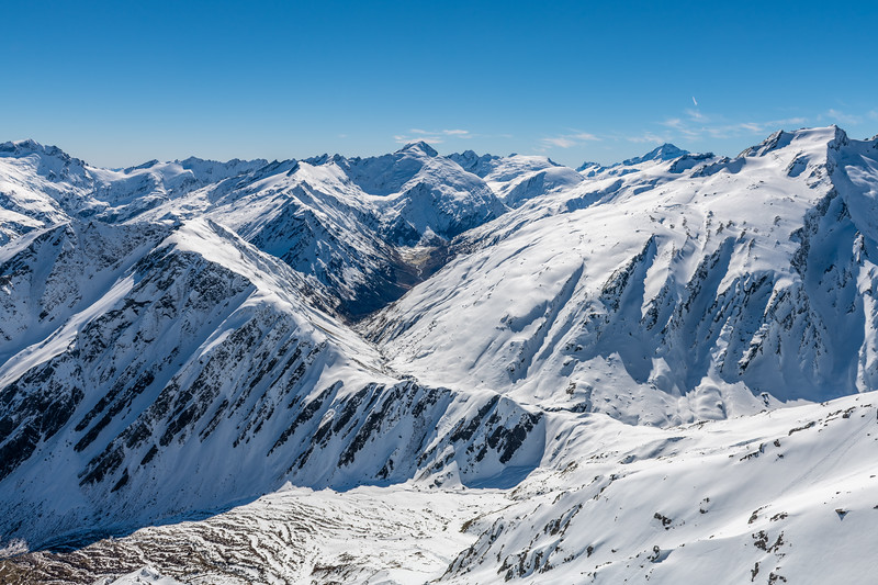 View north from the summit of Cleft Peak. From left to right are Mount Lydia, Mount Edward, Mount Maori, Mount Liverpool, Mount Aspiring and Headlong Peak. Rees Saddle and Snowy Creek are at centre image.