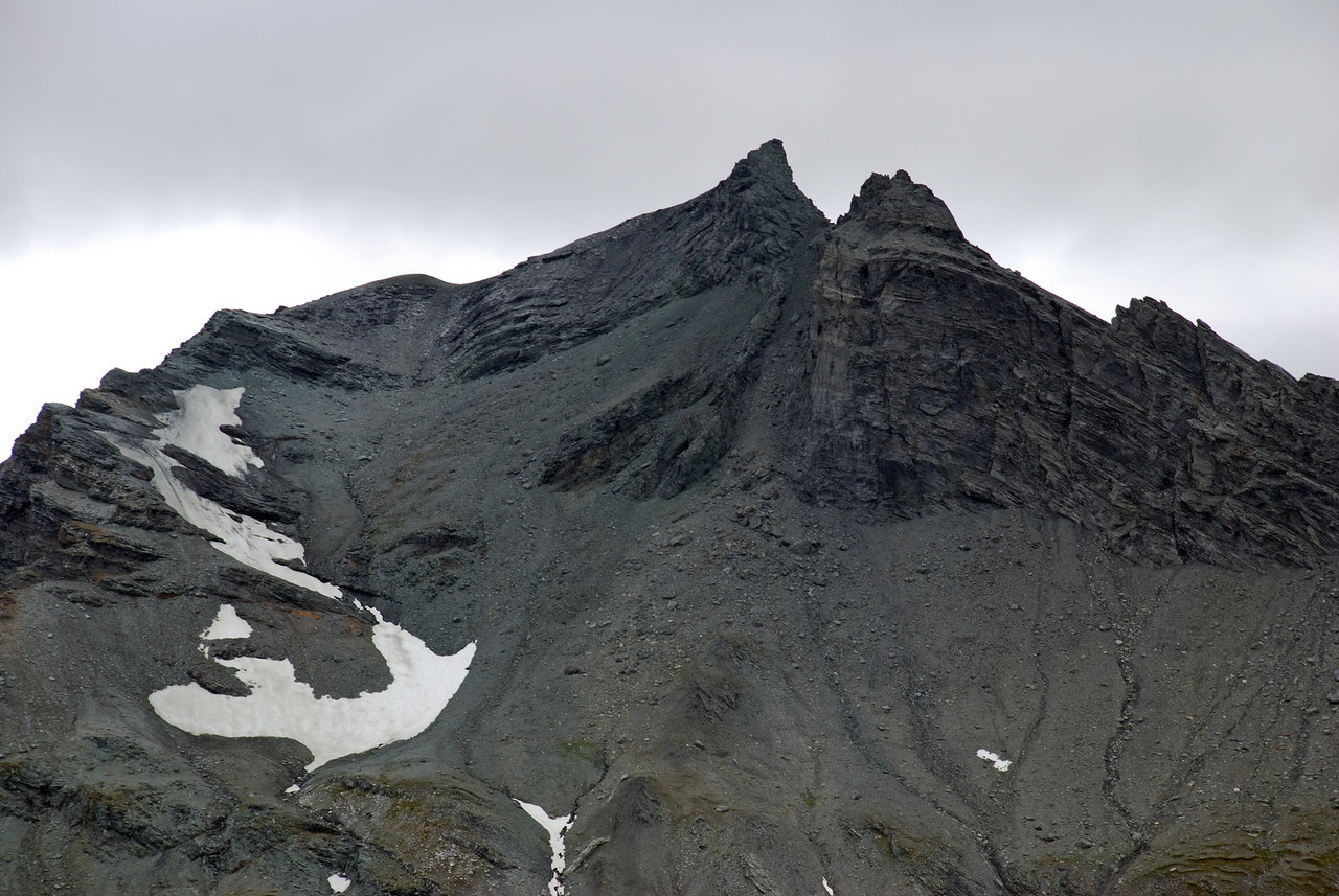 Dragonfly Peak from the south-west. Our descent route followed the right hand ridge then the scree gully between the two summits before sidling back left under the snow fields.