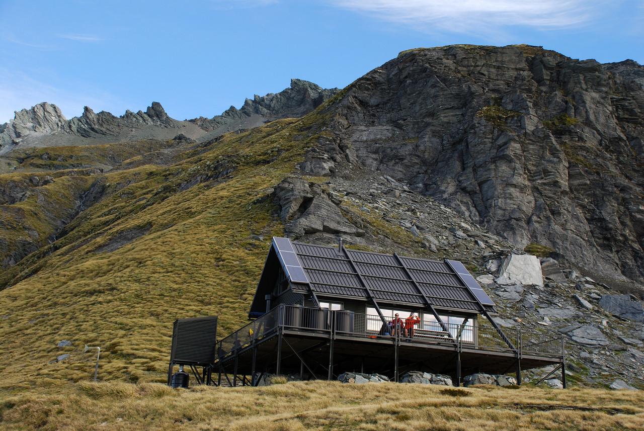The private hut on Albert Burn Saddle. Dragonfly Peak above.