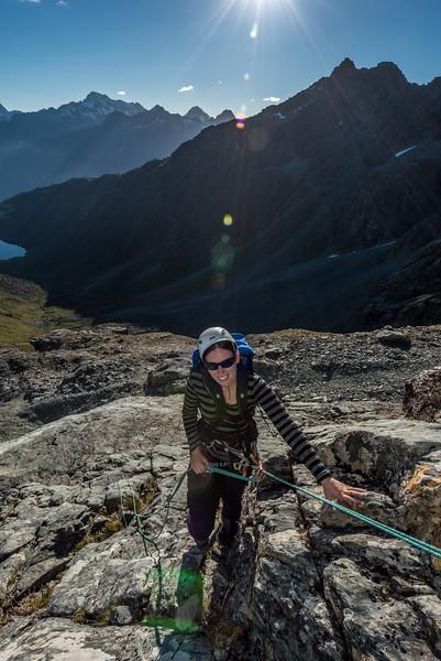 Descending the slabs on Emily Peak. Mount Christina in the background.