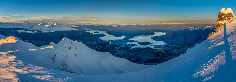Panorama from the summit of End Peak at sunset. Lake Wanaka is at centre image. Mt Alta and the Buchanan Peaks are on the left; Roys Peak on the right.