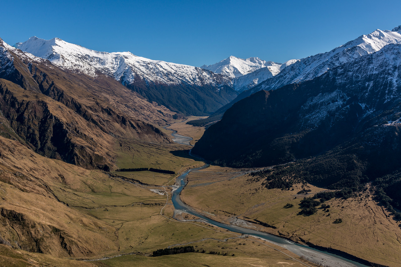 View up the Matukituki River West Branch from the spur west of Wishbone Creek. Mount Tyndall is on the far left. Mts Edward and Maoriri are just right of centre image, above Cascade Saddle