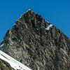 Sharks Tooth Peak summit pyramid. The unclimbed east ridge on left