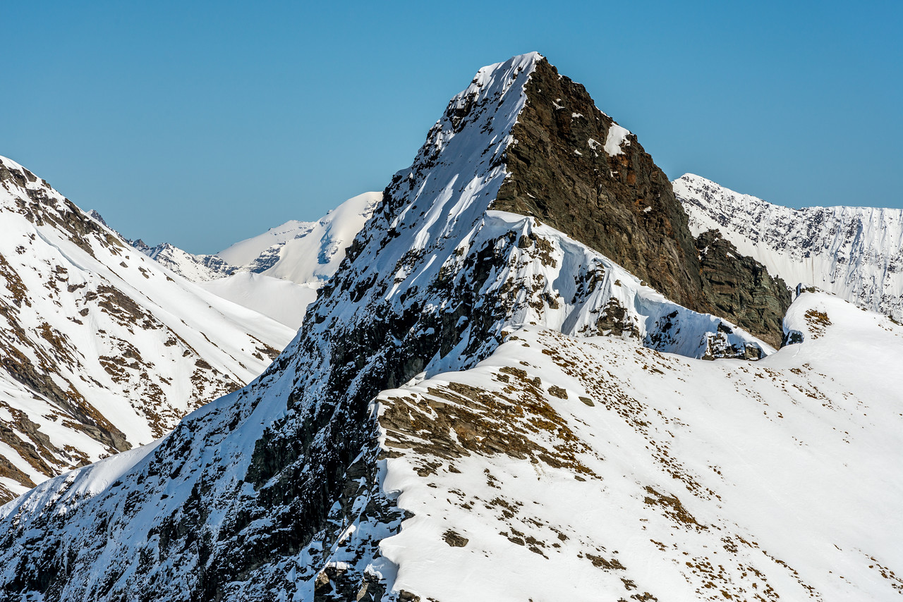The unclimbed east ridge of Sharks Tooth Peak, facing the photographer at centre image.